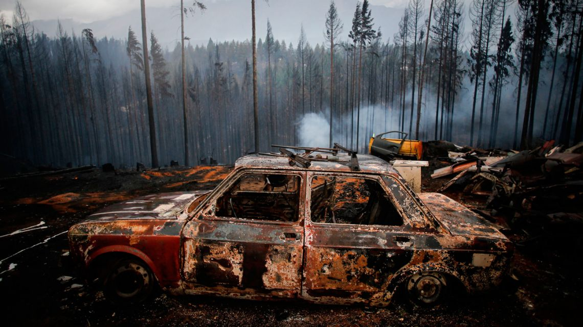 The remnants of a automobile after a fierce forest fire, pictured in a region near El Bolsón.
