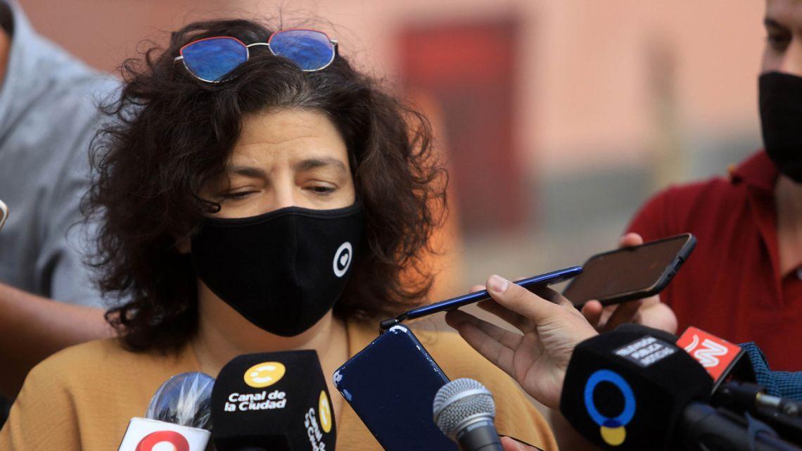 Health Minister Carla Vizzotti speaks to the press outside the Casa Rosada.