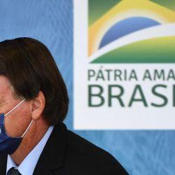 El presidente brasileño, Jair Bolsonaro, asiste al lanzamiento del Programa de Aguas Brasileñas en celebración del Día Internacional del Agua en el Palacio Planalto en Brasilia.   Foto:Evaristo Sa / AFP