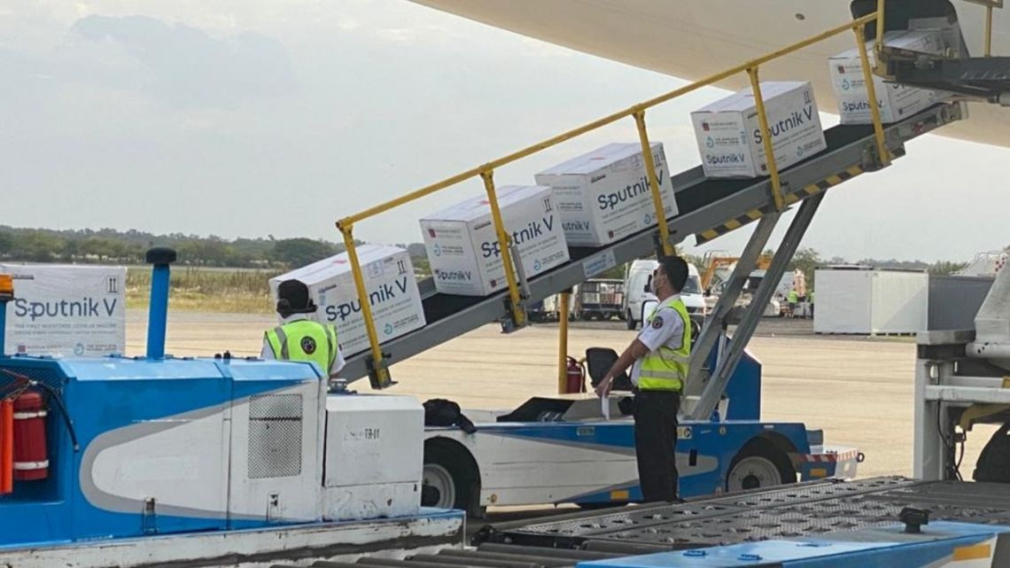 Workers take delivery of a new shipment of Sputnik V vaccines at Ezeiza international airport.