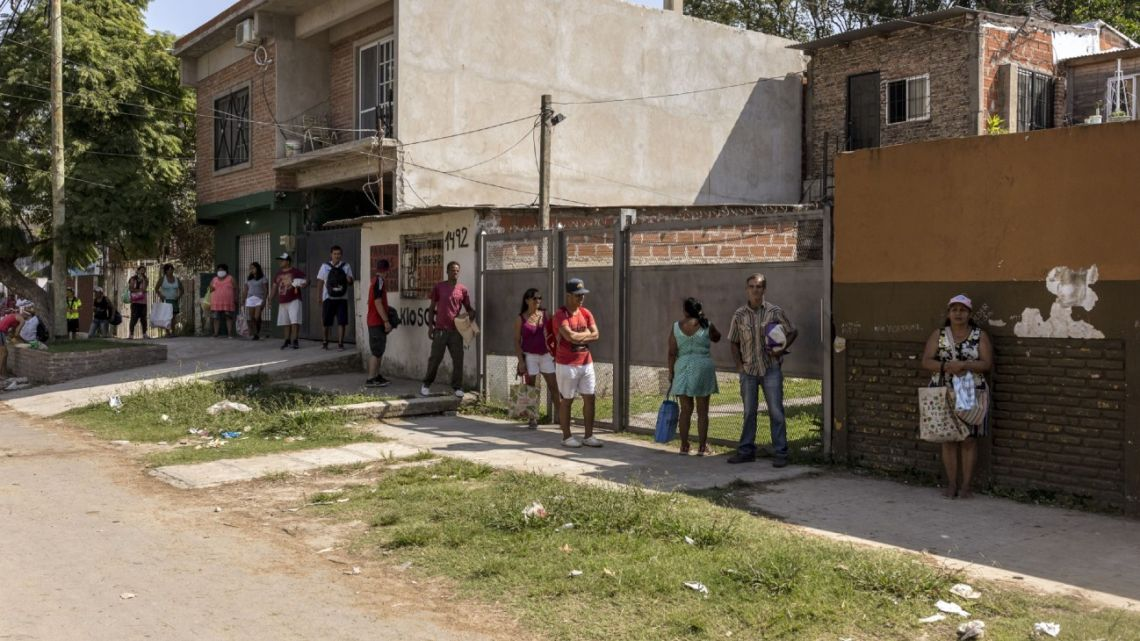 Customers line up outside a shop in Buenos Aires Province.
