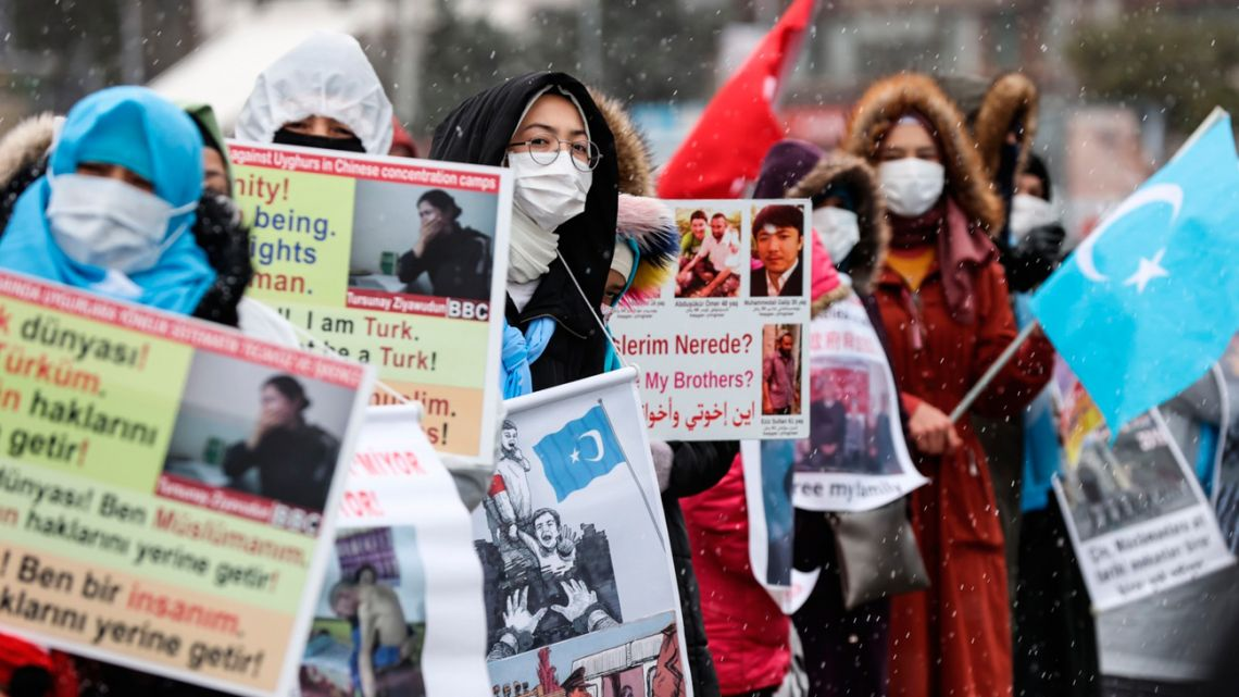 Protesters hold a demonstration to draw attention to alleged human rights abuses committed against the Uighurs in China.