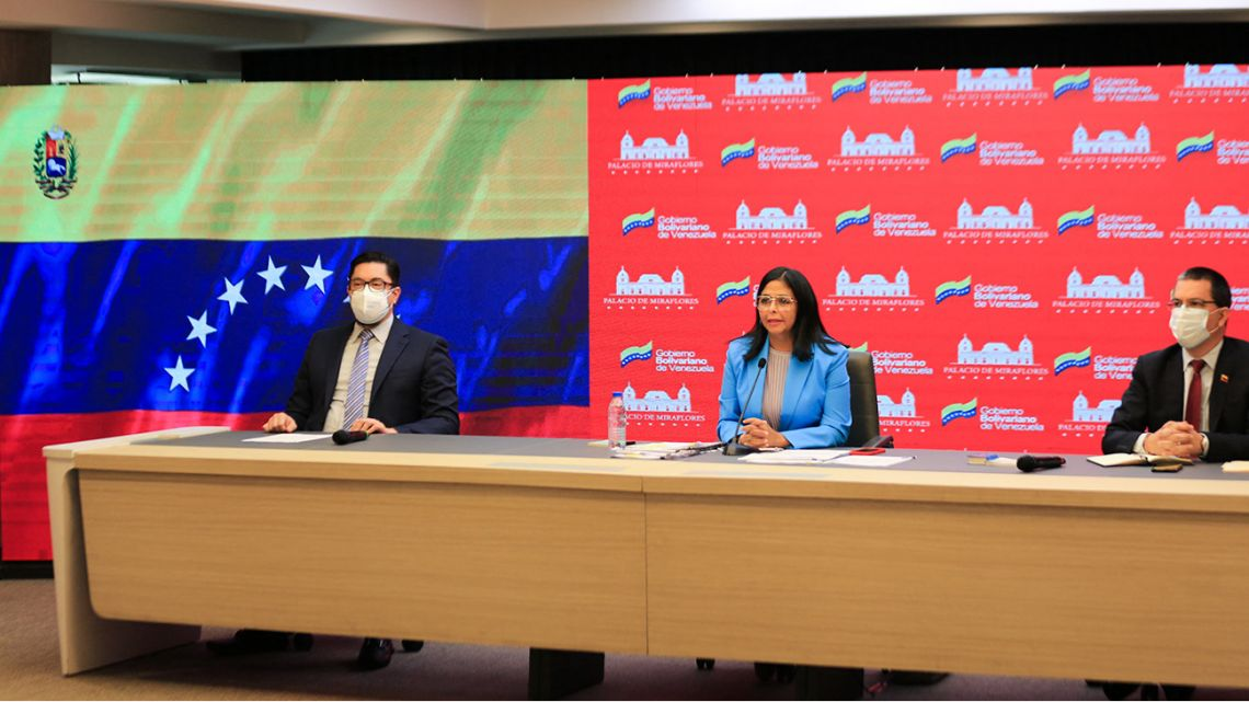 Handout photo released by the Venezuelan Presidency of Venezuela's Vice President Delcy Rodriguez (C), speaking next to Venezuelan Foreign Minister Jorge Arreaza (R) during a message televised at Miraflores Presidential Palace in Caracas on March 24, 2021.