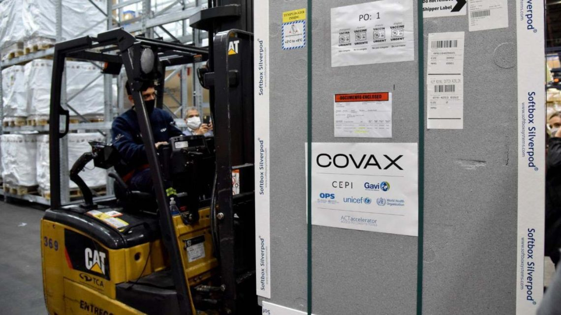 Argentina takes delivery of its first shipment of vaccines supplied through the Covax scheme, at Ezeiza international airport.