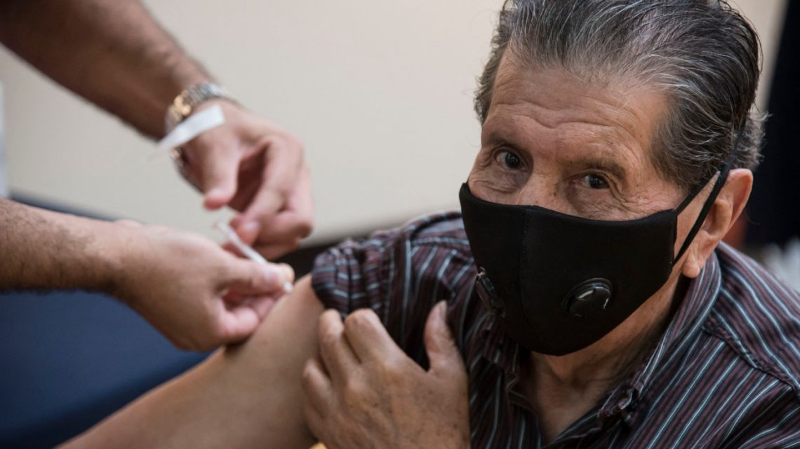 A man is inoculated with the Sputnik V vaccine against Covid-19 at the Lumiere movie theatre in Rosario, Santa Fe Province, on March 26, 2021.