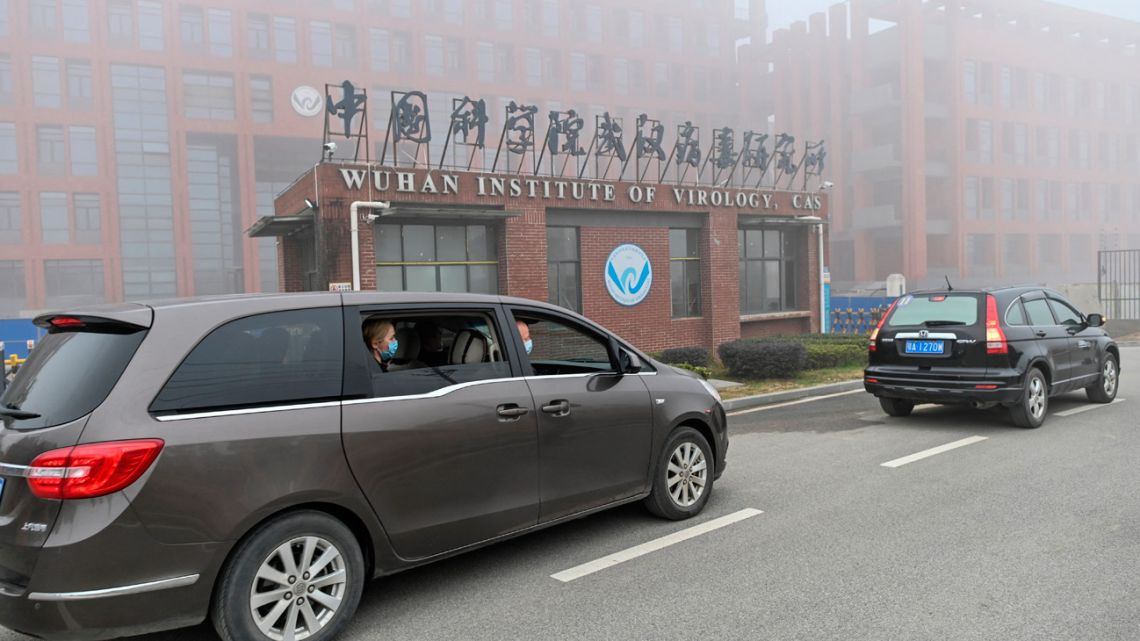 In this file photo taken on February 03, 2021 Peter Daszak (right), Thea Fischer (left) and other members of the World Health Organisation (WHO) team investigating the origins of the COVID-19 coronavirus, arrive at the Wuhan Institute of Virology in Wuhan in China's central Hubei province.