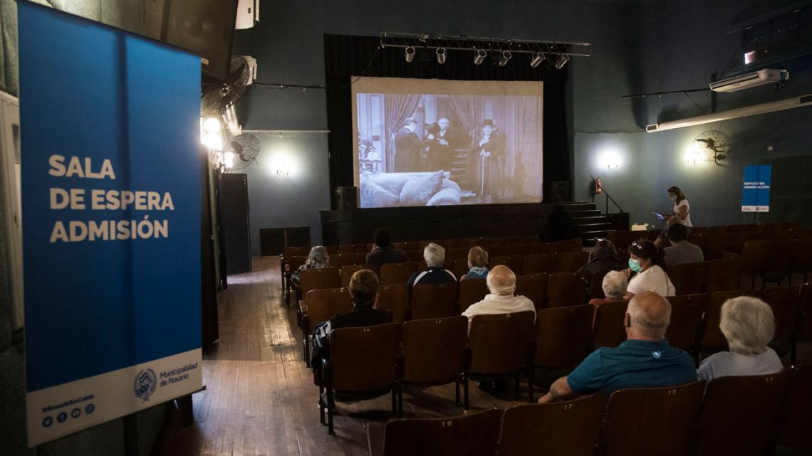 At the Cine Lumière Cultural Centre in Rosario, Santa Fe Province, elderly citizens wait to be vaccinated with the Sputnik V jab against Covid-19 while Charles Chaplin's movies are projected.
