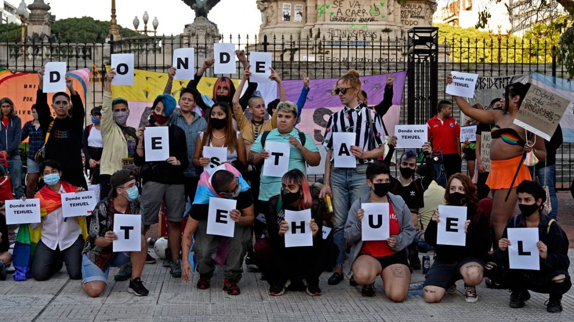 """Members of the LGBTI community hold letters reading """"Where is Tehuel?"""", referring to Tehuel de la Torre, a transgender man who disappeared on March 11, during a demonstration on the International Transgender Day of Visibility (TDOV) outside the Congress in Buenos Aires, on March 31, 2021."""