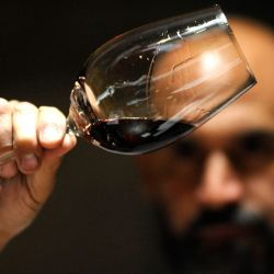 Enologist Javier Lo Forte looks at wine at the Pulenta Estate winery in Agrelo, Lujan de Cuyo.