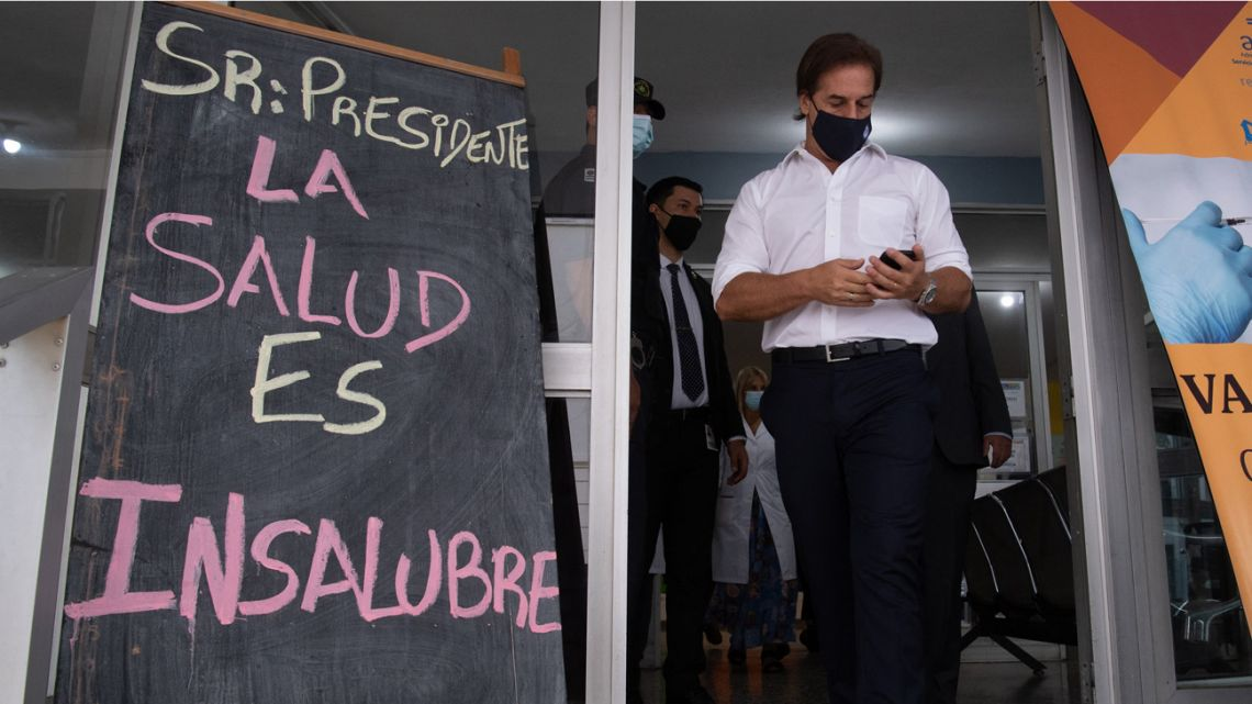 Uruguayan President Luis Lacalle leaves a hospital after being inoculated with the CoronaVac vaccine in Montevideo.