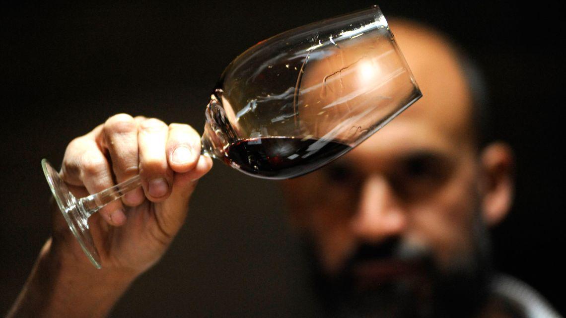 Enologist Javier Lo Forte looks at wine at the Pulenta Estate winery in Agrelo, Lujan de Cuyo.