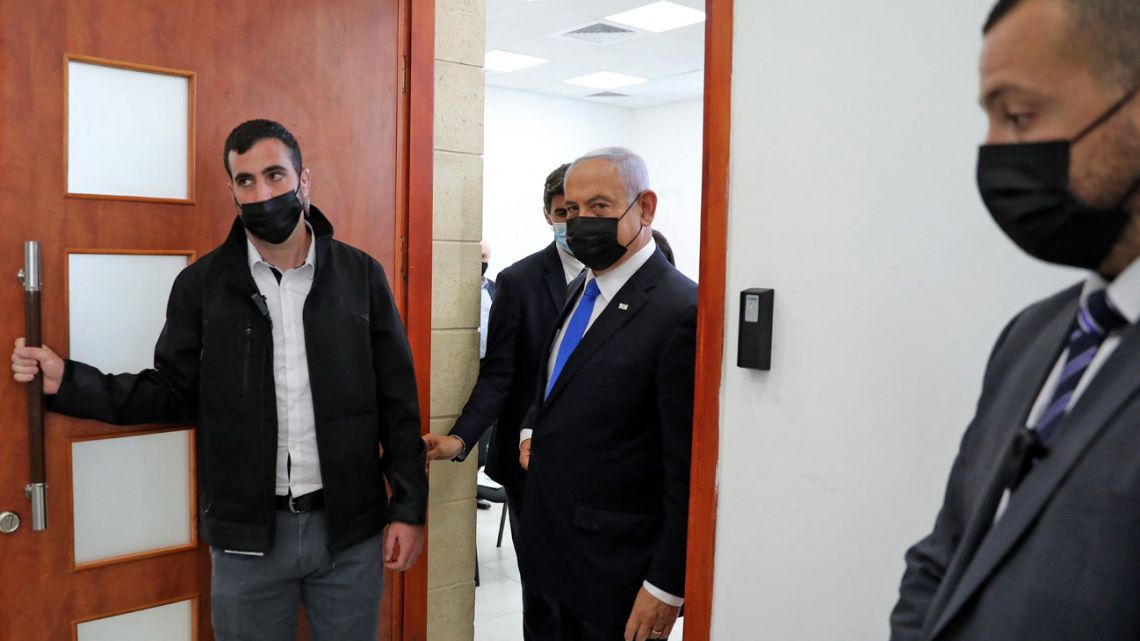 Israeli Prime Minister Benjamin Netanyahu leaves the courtroom at district court in Jerusalem on April 5, 2021, during his corruption trial.