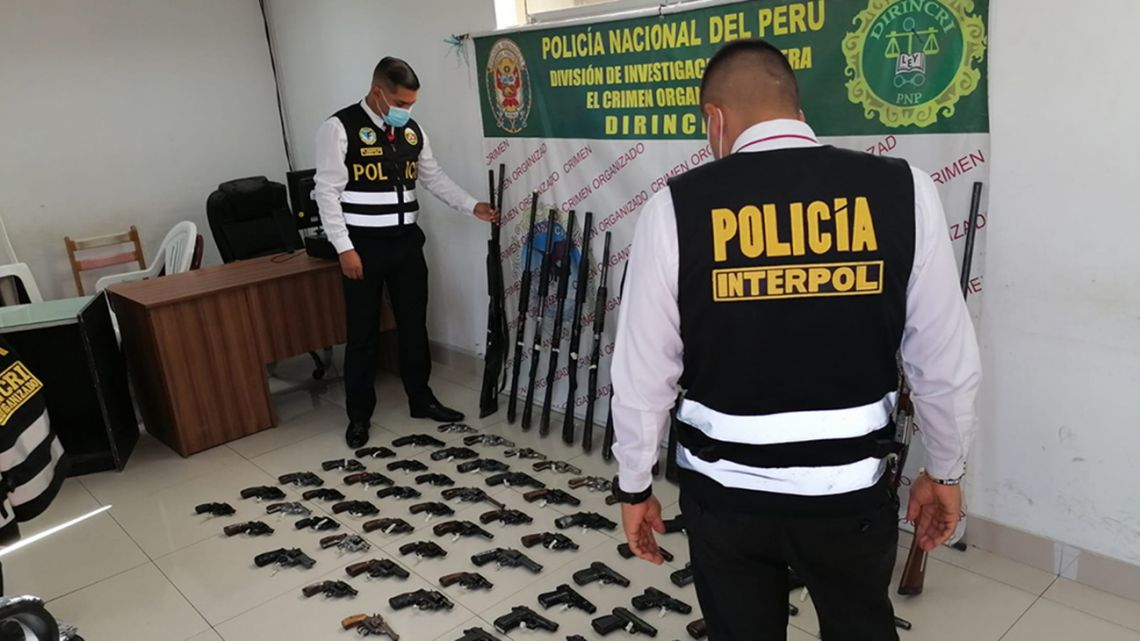 Peruvian authorities showcase illegal weapons seized as part of operation Trigger VI carried out last month.