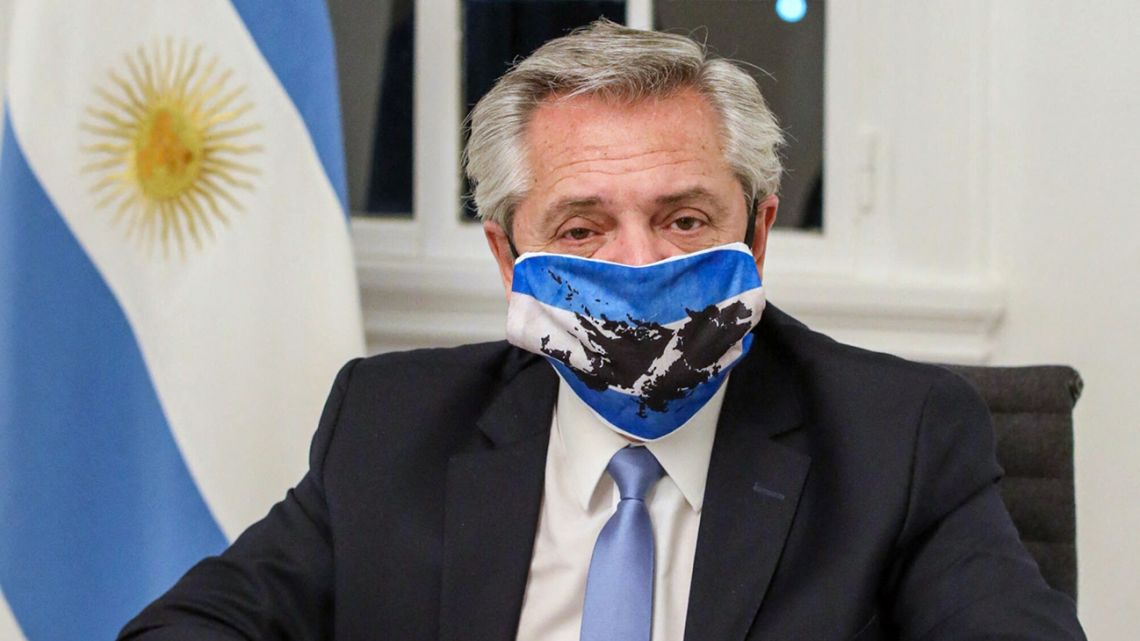 Handout file photo taken on June 10, 2020 released by Argentina's Presidency of President Alberto Fernandez wearing a face mask with the colors of Argentina's national flag and the map of the Malvinas / Falkland Islands at the Olivos Presidential residence in Olivos, Buenos Aires, on the Day of the Assertion of the Argentinian Rights over the Malvinas (Falklands), South Georgia, the South Sandwich and Surrounding Maritime Spaces.