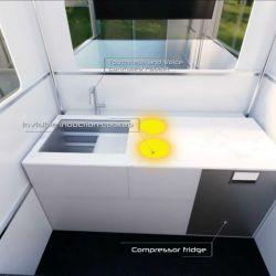 La cocina está conformada por una pequeña heladera y una mesada que cuenta con un fregadero y dos hornallas eléctricas.