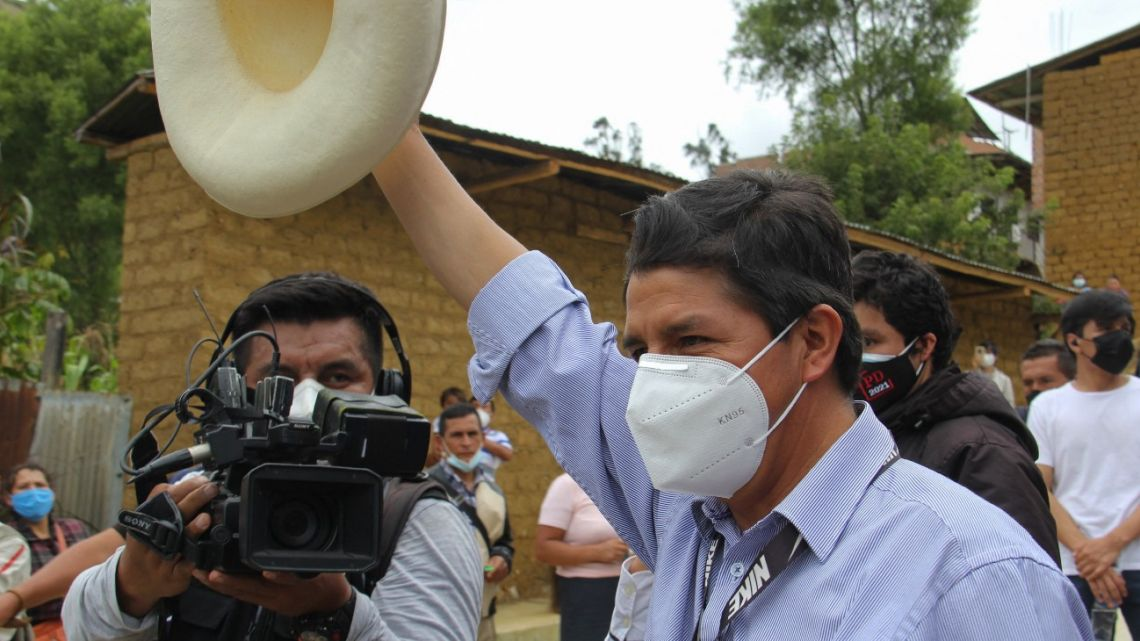 In this picture released by Peruvian news agency Andina, Peruvian presidential candidate for the Peru Libre (Free Peru) Party, Pedro Castillo, waves as he leaves a polling station in Cajamarca, Peru, after casting his vote during general elections on April 11, 2021.