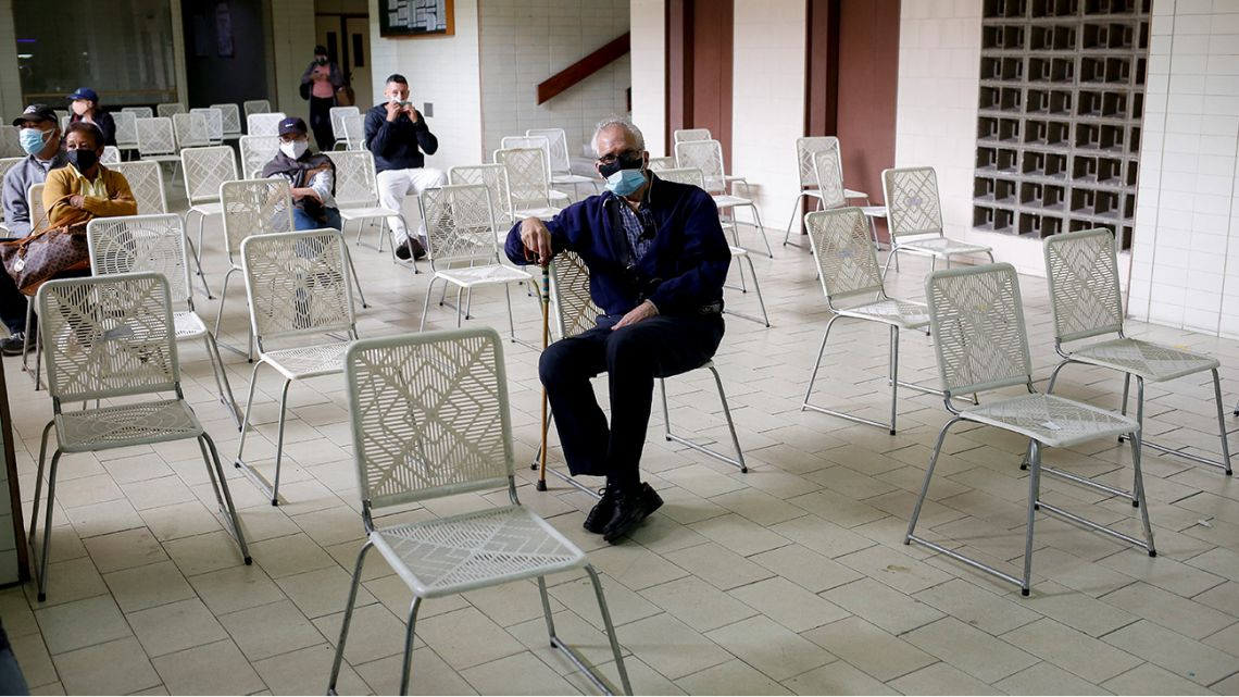 Elderly people wait to receive a dose of the Sputnik V vaccine against COVID-19 at the Victorino Santaella Hospital in Los Teques, Venezuela on April 9, 2021, amid the ongoing coronavirus pandemic.