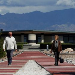 Architects Mario Yanzón (left) and Eliana Bórmida walk posing for a picture at Alfa Crux, a winery in the Uco Valley, San Carlos Department, in the Argentine province of Mendoza, on April 1, 2021. The winery was designed by the Mendoza-based Bórmida & Yanzón studio, which specialises in wine architecture and has built more than 30 wineries since 1988, many of which have received national and international awards.