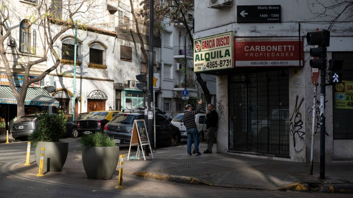 A sign indicating a property for rent hangs outside a building in the Palermo neighbourhood of Buenos Aires.