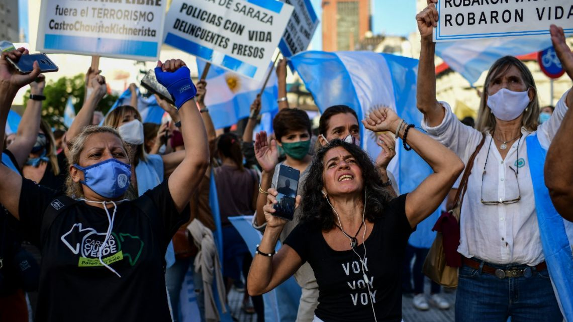 People protest against President Alberto Fernández and new restrictions to mitigate the spread of the novel coronavirus, on Avenida 9 de Julio in Buenos Aires, on April 17, 2021.
