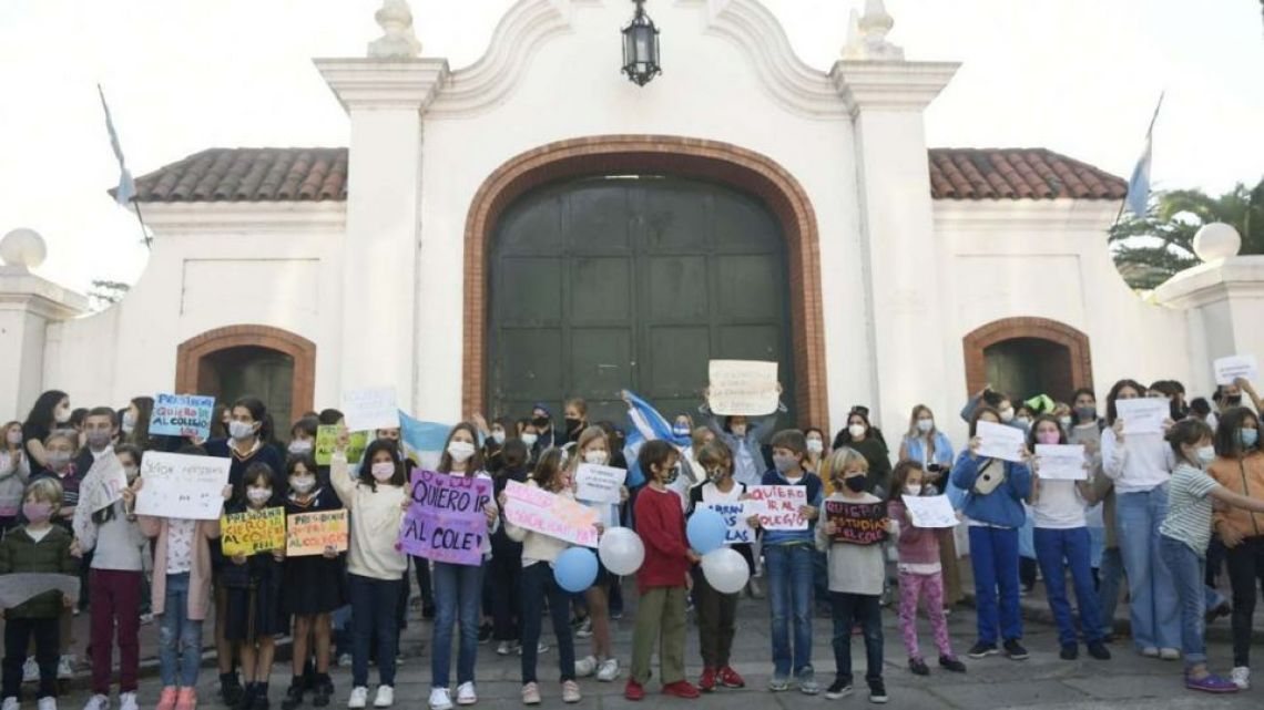 Parents in favour of in-person classes demonstrate outside the Olvios presidential residence on Monday morning.