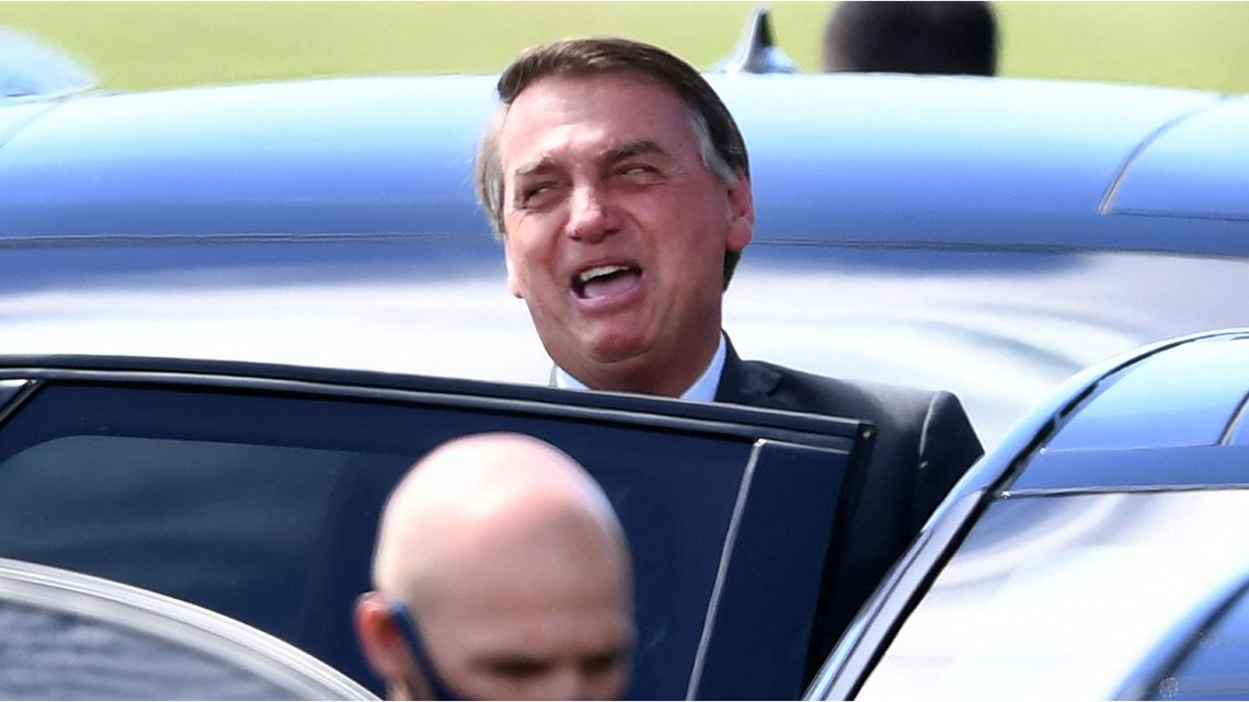 Brazilian President Jair Bolsonaro leaves Alvorada Palace in Brasilia on April 27, 2021.