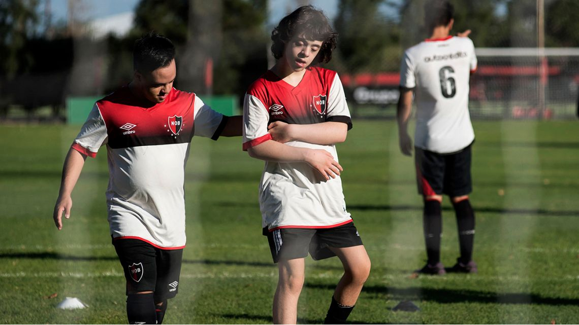 Boys take part in a class at the Newells Old Boys' Jorge B. Griffa training centre -an inclusive football school for children with Down Syndrome- in Rosario, Santa Fe, Argentina on April 22, 2021.