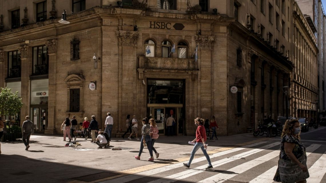 Pedestrians and commuters walk in the financial district of Buenos Aires.