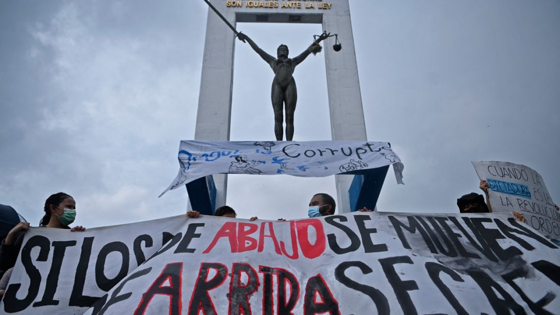Demonstrators hold a protest against the latest measures taken by El Salvador's Legislative Assembly, including the dismissal of the Supreme Court judges and the Attorney General, in San Salvador, on May 2, 2021.