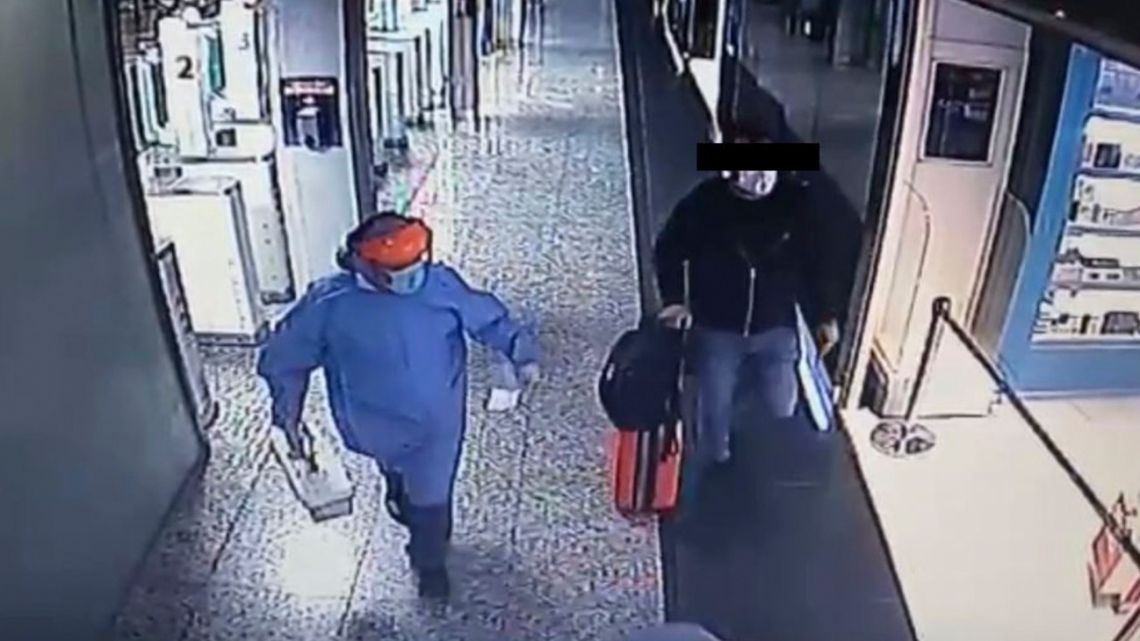Security camera footage of the unidentified 29-year-old infected with coronavirus who was arrested at Ezeiza International Airport after flying back from Miami to Buenos Aires with a fake medical certificate showing that he had not tested positive for Covid-19.