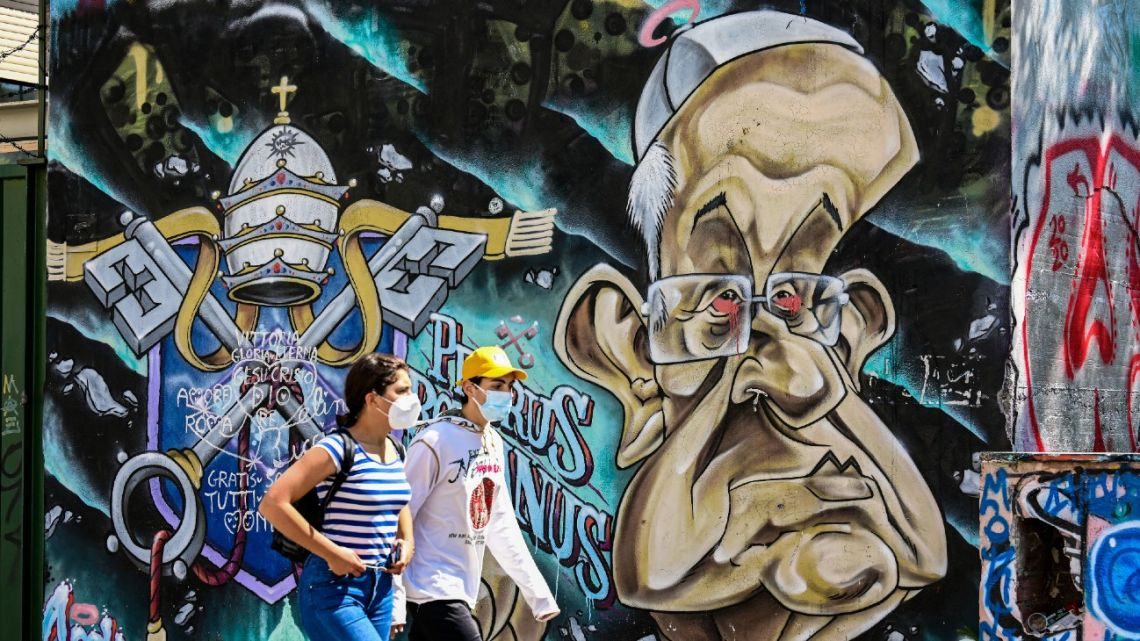 A 2017 mural by French street artist Sock Wild Sketch, showing Pope Francis and entitled 'Petrus Romanus,' is pictured in Rome on May 8, 2021.