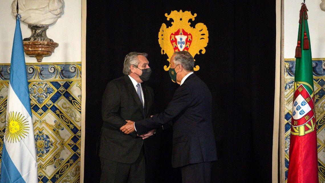 President Alberto Fernández is welcomed by Portuguese President Marcelo Rebelo de Sousa after arriving in Lisbon.
