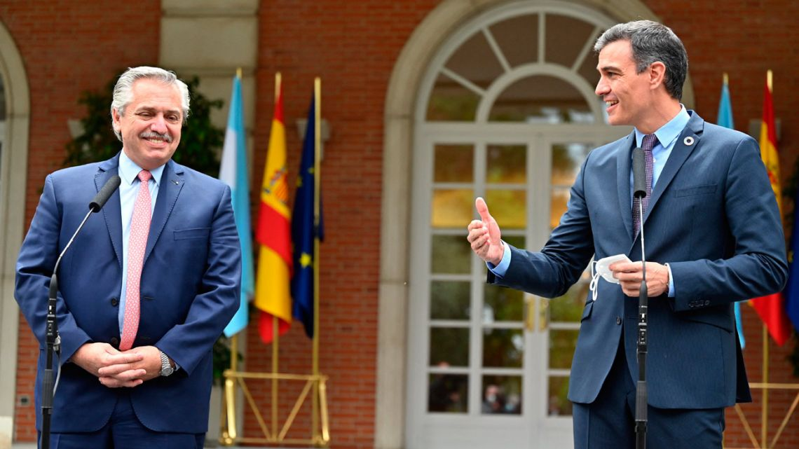 President Alberto Fernández (left) and Spain Prime Minister Pedro Sánchez talks to the press outside the Moncloa Palace in Madrid on May 11, 2021.