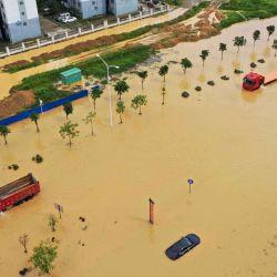 hina, Liuzhou: vehículos se sumergen en una calle inundada después de que una fuerte tormenta acompañada de lluvia azotara la ciudad.   Foto:TPG vía ZUMA Press / DPA