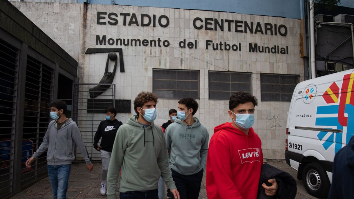 Uruguay's Nacional footballers leave the Centenario stadium after being inoculated with the CoronaVac vaccine, developed by China's Sinovac laboratory against COVID-19, at the Centenario stadium in Montevideo on May 7, 2021. The vaccines were donated by Chinese laboratory Sinovac to immunize South American football players, who will take part in the Conmebol Copa America and other tournaments.