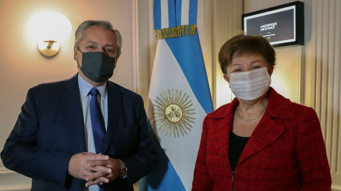 Handout photo released by Presidency on May 14, 2021 shows President Alberto Fernández and International Monetary Fund Managing Director Kristalina Georgieva posing for a photo after a meeting in Rome, Italy.
