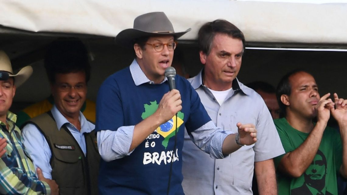 Brazil's Environment Minister Ricardo Salles (second left) delivers a speech next to President Jair Bolsonaro during a demonstration by farmers against the Supreme Court and calling for the end of Covid-19 restrictions, in Brasilia, on May 15, 2021.