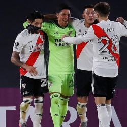 River Plate's emergency goalkeeper Enzo Pérez celebrates with teammates at the end of the side's Copa Libertadores football tournament group stage match against Colombia's Independiente Santa Fe at the Monumental in Buenos Aires, on May 19, 2021.