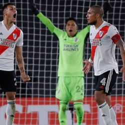 River Plate players, including emergency goalkeeper Enzo Pérez, celebrate at the end of their Copa Libertadores football tournament group stage match against Colombia's Independiente Santa Fe at the Monumental in Buenos Aires, on May 19, 2021.