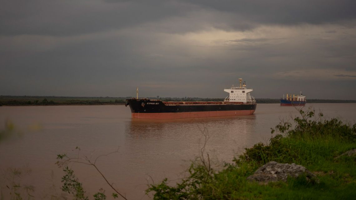 An grain-export ship awaits instructions off a port in Rosario.