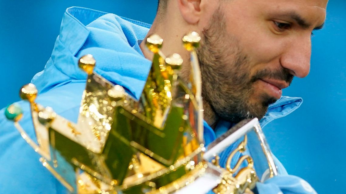 Sergio Agüero holds the Premier League trophy during the award ceremony after the English Premier League football match between Manchester City and Everton at the Etihad Stadium in Manchester, north west England, on May 23, 2021.