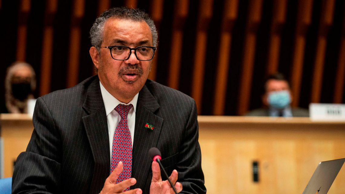 A handout photograph taken and released by the World Health Organisation (WHO) on May 24, 2021, shows the Director General of the World Health Organization (WHO) Tedros Adhanom Ghebreyesus delivering a speech during the 74th World Health Assembly, at the WHO headquarters, in Geneva. Vaccine sharing, strengthening the WHO and adopting a pandemic treaty were among proposals from world leaders on May 24, 2021 on how to halt the Covid-19 pandemic and prevent future health catastrophes.