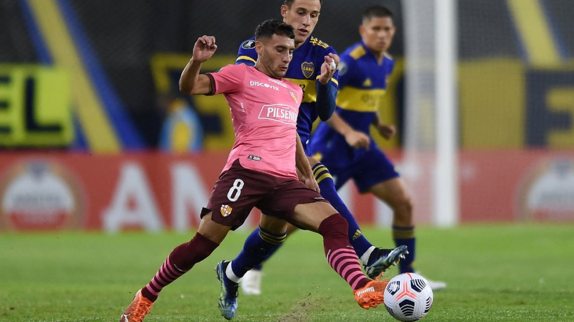 Barcelona (Ecuador) player Leandro Martínez (left) and Boca Juniors' player Nicolas Capaldo vie for the ball during the recent Copa Libertadores football tournament group stage match at La Bombonera in Buenos Aires on May 20, 2021.