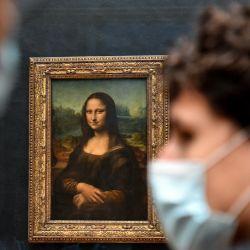 Los visitantes pasan junto a la pintura    Foto:Alain Jocard / AFP