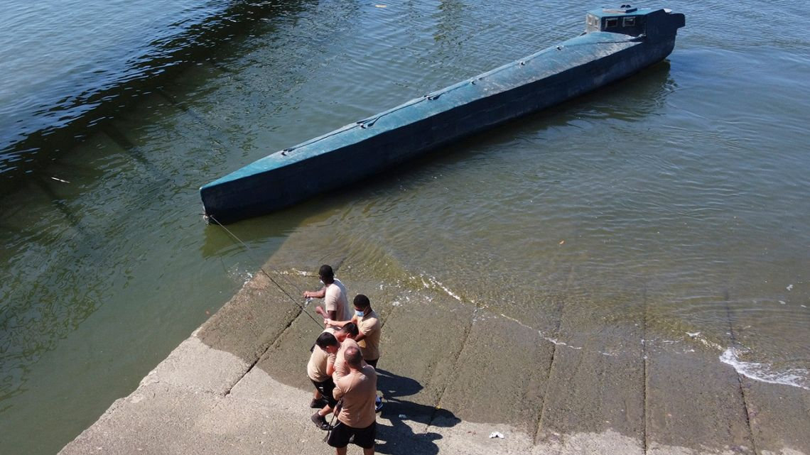 Aerial view of a seized narco-submarine towed by Colombian Navy soldiers in Buenaventura, Valle del Cauca department, Colombia, on March 21, 2021.