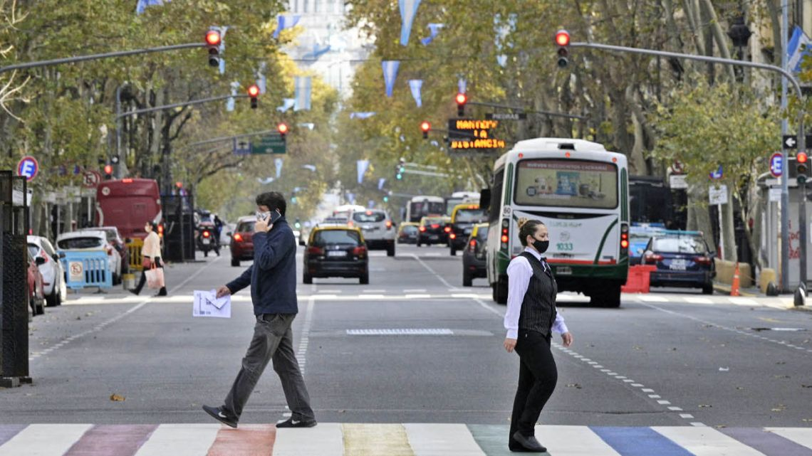Residents walk in Buenos Aires during the coronavirus pandemic, on Friday, May 28, 2021.