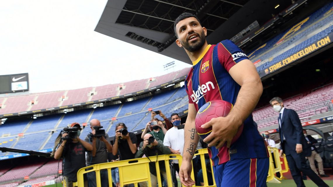 Former Manchester City player, Argentine striker Sergio Agüero, poses on the pitch of the Camp Nou stadium during his official presentation as new player of FC Barcelona on May 31, 2021.