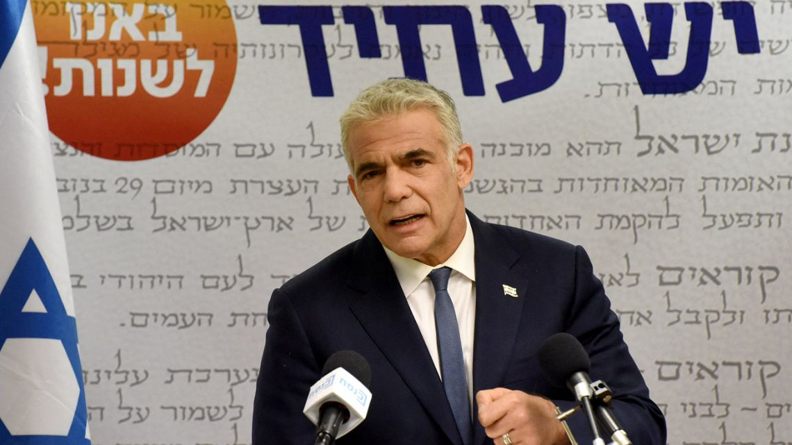 """Israel's centrist opposition leader Yair Lapid delivers a statement to the press at the Knesset (Israeli parliament) in Jerusalem on May 31, 2021. Lapid said """"many obstacles"""" remain before a diverse coalition to oust long-serving right-wing Prime Minister Benjamin Netanyahu can be agreed."""
