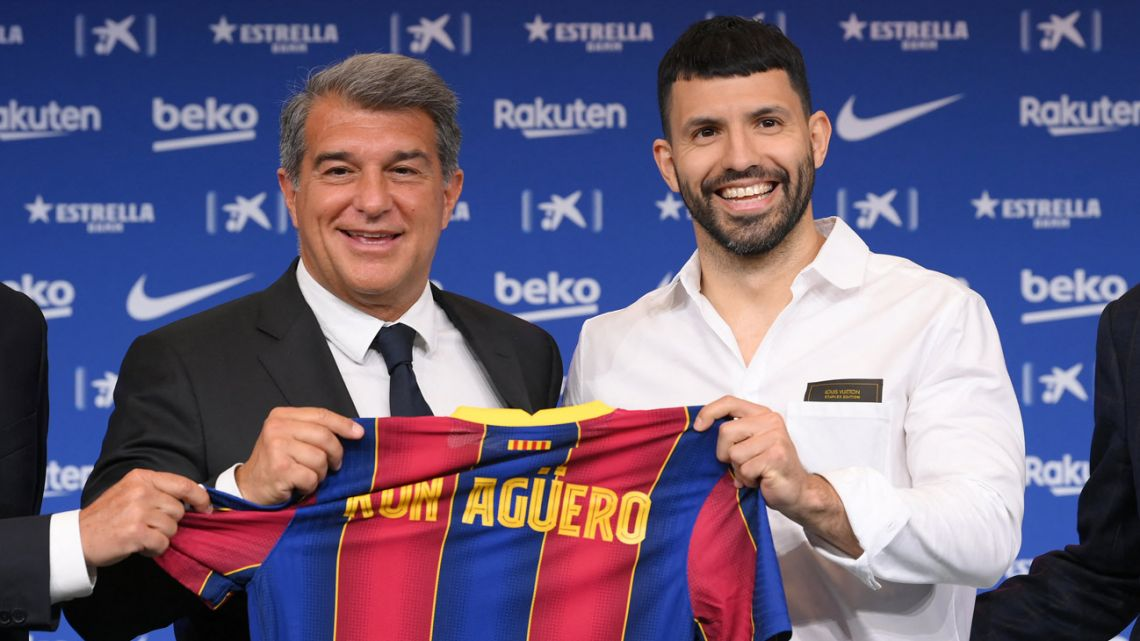 Argentine forward Sergio Agüero (right) poses with FC Barcelona President Joan Laporta during his official presentation as new player of FC Barcelona at the Camp Nou stadium in Barcelona on May 31, 2021.