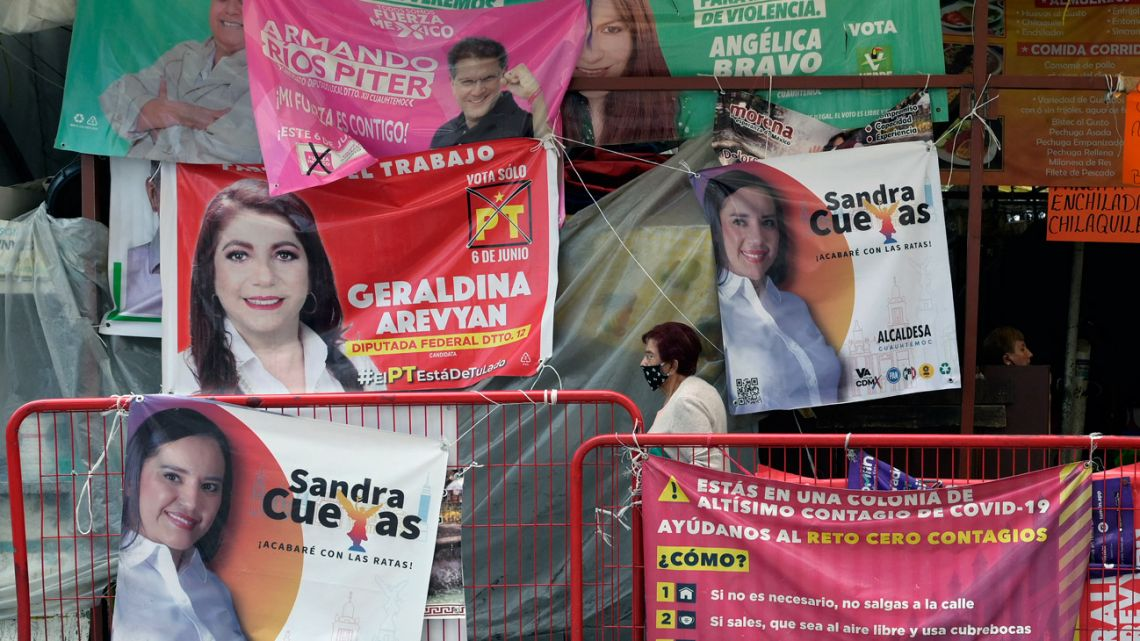 Electoral propaganda of different political parties and candidates is seen in Mexico City on June 1, 2021.